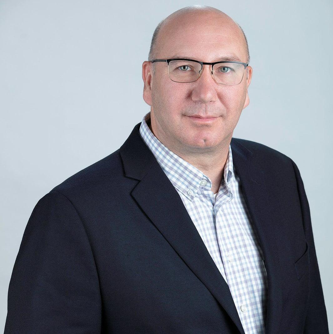 Tyson J. Roffey, Board member of the Ontario Caregiver Organization, smiling portrait